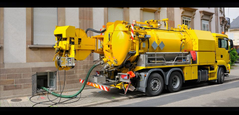 Yellow septic truck